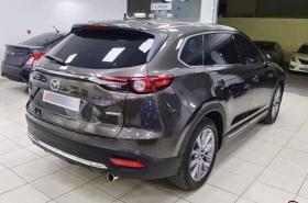 Mazda               CX